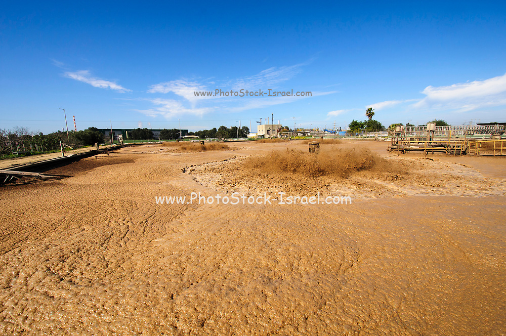 Sewerage treatment facility. The treated water is then used for irrigation and agricultural use. Photographed near Hadera, Israel Israel, <br /> sludge treatment pool. Agitating and airing the water to improve biological breakdown of the sludge