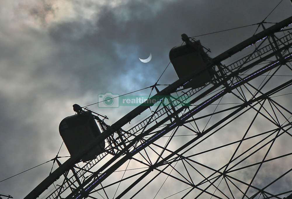 The Coca-Cola Orlando Eye, a 400-foot tall observation wheel, is illuminated during the solar eclipse on Monday, Aug. 21, 2017. In Central Florida, eager eclipse watchers saw about 85 percent to 88 percent of the sun blotted out when the eclipse reached its peak. Photo by Red Huber/Orlando Sentinel/TNS/ABACAPRESS.COM