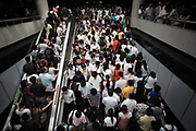 Morning commuters swarm through the People's Square subway interchange station in downtown Shanghai, China on 13 July 2009. Shanghai's subway system, with a total annual passenger flow of over 700 million, is the world's 10th largest transportation network in traffic. The city is also quickly expanding it's subway system, to accommodate a swelling population of over 23 million residents according to the latest census in 2010.