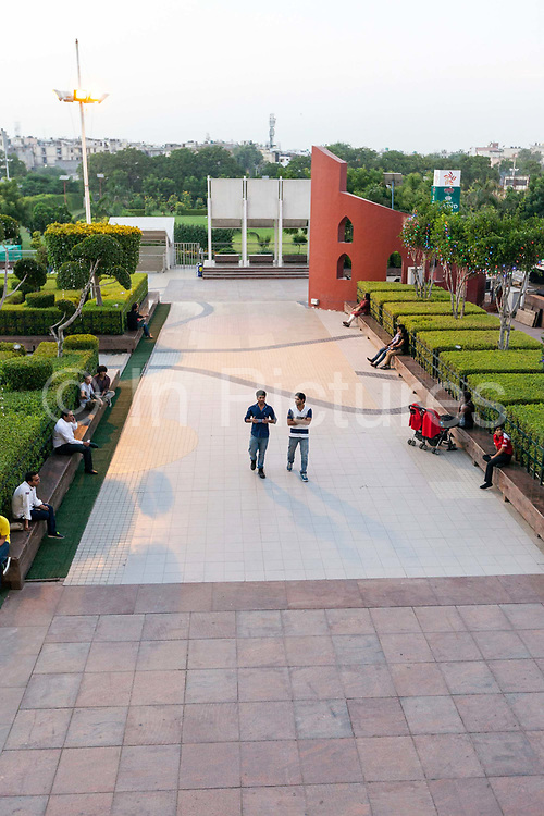 Shoppers walking through the courtyard of the Ambiance Mall, Saket, New Delhi, India