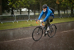 © Licensed to London News Pictures. 01/10/2021. London, UK. A man cycles during heavy rain in Greenwich Park in South East London. Rain showers are forecasted to continue in parts of London and South East England for the rest of the week.  Photo credit: George Cracknell Wright/LNP