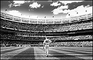NEW YORK, NY - SEPTEMBER 22:  (EDITORS NOTE: Image has been converted to black and white) Mariano Rivera #42 of the New York Yankees walks out of the bullpen before the game against the San Francisco Giants during interleague  play on September 22, 2013 at Yankee Stadium in the Bronx borough of New York City. Rivera was honored by the New York Yankees today with Mariano Rivera Day.  (Photo by Elsa/Getty Images)