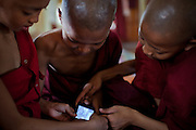 A group of young monks experience electronic toys for the first time.