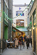 Early evening at Kingly Court in Soho on the 23rd March 2018 in Central London in the United Kingdom. Just off Carnaby Street, Kingly Court is a three-storey, al-fresco dining destination in the heart of Londons West End with independent restaurants, cafes and late-night cocktail bars