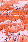 Evening light on snow-dusted rock formations below Sunset Point, Bryce Canyon National Park, Utah