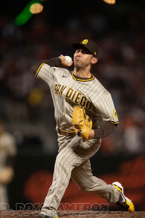 Oct 1, 2021; San Francisco, California, USA; San Diego Padres pitcher Javy Guerra (8) delivers a pitch against the San Francisco Giants during the fifth inning at Oracle Park. Mandatory Credit: D. Ross Cameron-USA TODAY Sports