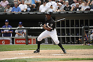 CHICAGO - MAY 22:  Juan PIerre #1 of the Chicago White Sox bats against the Los Angeles Dodgers on May 22, 2011 at U.S. Cellular Field in Chicago, Illinois.  The White Sox defeated the Dodgers 8-3.  (Photo by Ron Vesely)  Subject:   Juan Pierre