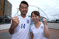 two England fans pose for a photo outside Wembley Stadium before k/o.FIFA World cup qualifying match, european group F, England v Malta at Wembley Stadium in London on Saturday 8th October 2016.<br /> pic by John Patrick Fletcher, Andrew Orchard sports photography.
