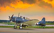 A SBD-5 Douglas Dauntless torpedo bomber, owned and operated by the Commemorative Air Force - Dixie Wing.  Photographed in the early morning light at Atlanta's DeKalb Peachtree Airport.