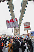 People marched from South London and East London to City Hall to demand better homes for Londoners and an end to the housing crisis. Demands included rent controls, affordable and secure homes for all, an end to the Bedroom Tax and welfare caps and the building of new council houses. The event was called by Defend Council Housing and  South London People's Assembly. And the East London route started at Parish Church of St. Leonard, Shoreditch, London, United Kingdom. 31 Jan 2015.Guy Bell, 07771 786236, guy@gbphotos.com