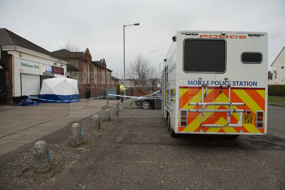 © Licensed to London News Pictures. 25/03/2016.  <br /> <br /> Pictured: Police Scotland have set up a mobile Police Station at the crime scene.<br /> <br /> Police Scotland have focused the centre of the murder investigation of 15 year old Paige Doherty in Clydebank, Glasgow around the home and business premises of suspect John Leathem as they search his house and Delicious Deli near Fleming Street, Clydebank Glasgow on Friday 25th March 2016.<br /> <br />  Photo credit should read Max Bryan/LNP