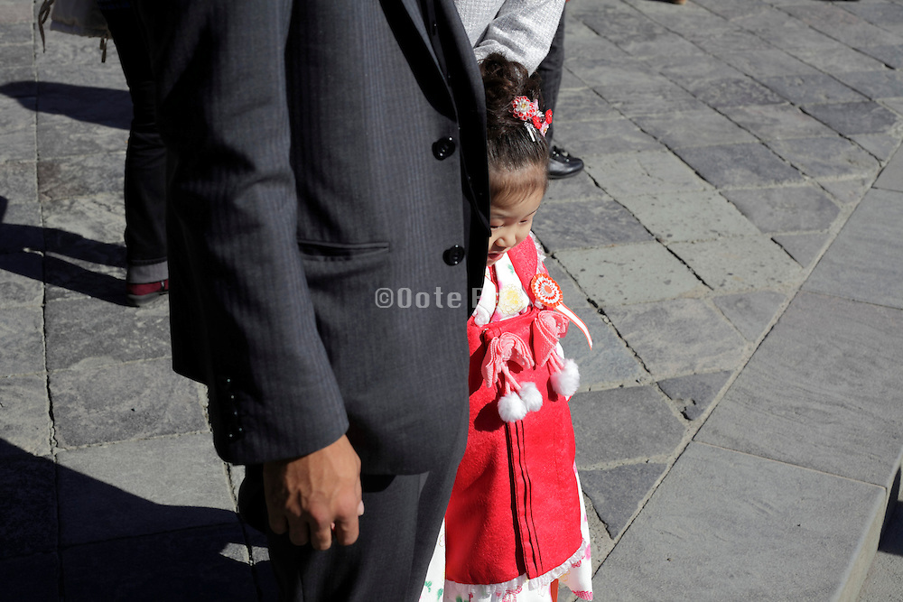 father posing with child for her Shichi Go San celebration