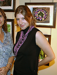 TARA SUMMERS daughter of Martin Summers at a an exhibition of prints by art dealer Martin Summers held at 73 Glebe Place, London on 29th June 2004.