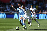 Gylfi Sigurdsson of Swansea city holds off Geoff Cameron of Stoke city (l).  Premier league match, Swansea city v Stoke City at the Liberty Stadium in Swansea, South Wales on Saturday 22nd April 2017.<br /> pic by Andrew Orchard,