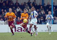 Photo: Kevin Poolman.<br />Colchester United v Bradford City. Coca Cola League 1. 04/02/2006.<br />Bradford's Tom Penford and Neil Danns clash.