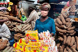 May 4, 2020, Lagos, Nigeria: A woman wearing facemask stands with her goods inside Mile 12 Food Market in Lagos, Nigeria on Monday, May, 4 2020. In order to cushion the hardship of Coronavirus (COVID-19) pandemic lockdown, government has relaxed its rules by allowing people to move and open business in the day time, imposed curfew form 8PM -6AM and made it compulsory for everybody to wear facemask in public places from Monday, May 4, 2020. Photo by Adekunle Ajayi  (Credit Image: © Adekunle Ajayi/NurPhoto via ZUMA Press)