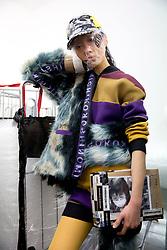 A model during the Michiko Koshino London Fashion Week Men's AW18 presentation, held at Hollybush Gardens, London.