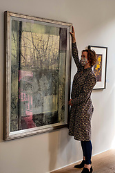 Pictured: Gallery Director Christina Jansen makes the finishing adjustments to Landscape Refection (2019) by Victoria Crowe OBE<br />