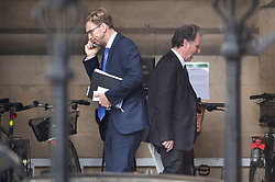 © Licensed to London News Pictures. 03/04/2019. London, UK. Conservative MPs Oliver letwin (R) and Tobias Ellwood pass each other in Parliament. Labour Party Leader Jeremy Corbyn is holding talks with Prime Minister Theresa May to seek a way forward with the Brexit deadlock. Photo credit: Peter Macdiarmid/LNP
