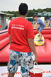Latitude Festival 2017, Henham Park, Suffolk, UK. ActionAid surf simulator. ActionAid works with the poorest women & girls internationally changing their lives for good. At Latitude they are highlighting the challenges women & girls across the world face because of their periods