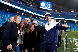 Tottenham Hotspur's Eric Dier poses for a selfie with fans before the Premier League match at the Etihad Stadium, Manchester.