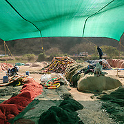 Fishing nets are laid out before being repaired.