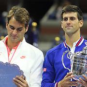 Novak Djokovic, (right), Serbia and Roger Federer, Switzerland, at the trophy presnenation after Novak Djokovic, Serbia won the Men's Singles Final against Roger Federer, Switzerland, during the US Open Tennis Tournament, Flushing, New York, USA. 13th September 2015. Photo Tim Clayton