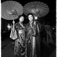 Serene geishas walk the streets of Greenwich Village, during Halloween, in NYC.