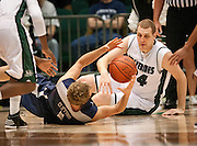 UVU center Ben Aird (34) looks on as Utah State's forward Ben Clifford (1) pulls in a loose ball during the second half of the NCAA basketball game between UVU and Utah State in the UCCU Center in Orem, Saturday, Dec. 15, 2012.