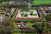 Nederland, Drenthe, Gemeente Noordenveld, 01-05-2013; gevangenisdorp Veenhuizen, gesticht in 1823 door de Maatschappij van Weldadigheid voor de heropvoeding van bedelaars en landlopers. Het Tweede Gesticht - met rood pannendak - is een van de oude dwanggestichten en huisvest nu het Gevangenismuseum.<br /> Veenhuizen prison village, founded in 1823 by the Benevolent Society for the rehabilitation of beggars and vagrants.<br /> The 'Second Establishment' - with red tile roof - is one of the old detention centers and now houses the Prison Museum.<br /> <br /> luchtfoto (toeslag op standard tarieven)<br /> aerial photo (additional fee required)<br /> copyright foto/photo Siebe Swart