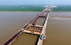 April 17, 2018 - Zhengzhou , China - Aerial photo shows the Zhengzhou Yellow River bridge under construction on the Zhengzhou-Jinan high-speed railway. The bridge is expected to be completed in April of 2020. (Credit Image: © Zhu Xiang/Xinhua via ZUMA Wire)