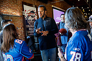 SHOT 12/10/17 1:28:52 PM - Former Buffalo Bills wide receiver and Hall of Fame player Andre Reed signs autographs and meets with fans at LoDo's Bar and Grill in Denver, Co. as the Buffalo Bills played the Indianapolis Colts that Sunday. Reed played wide receiver in the National Football League for 16 seasons, 15 with the Buffalo Bills and one with the Washington Redskins. (Photo by Marc Piscotty / © 2017)