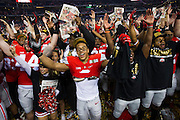 The Ohio State Buckeyes celebrate after defeating the Oregon Ducks during the College Football Playoff National Championship Game at AT&T Stadium on January 12, 2015 in Arlington, Texas.  (Cooper Neill for The New York Times)
