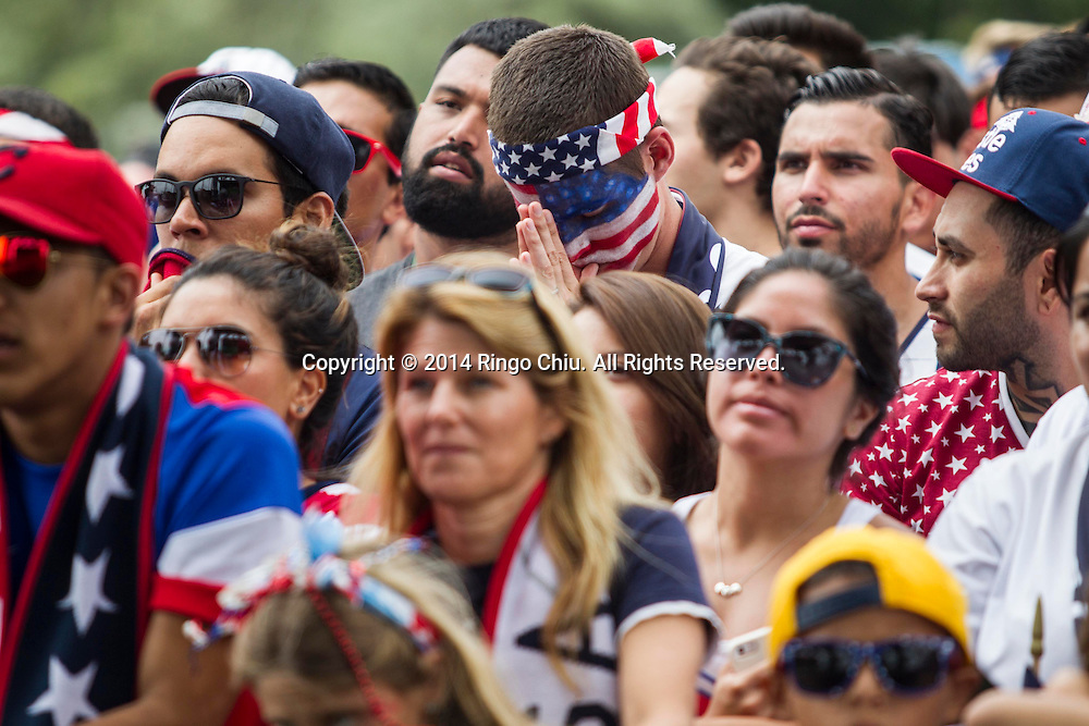 United States fans react while watching the World Cup soccer match between the U.S. and Belgium at a viewing party on Tuesday, July 1, 2014, in Redondo Beach, California. Belgium won 2-1 in extra time. <br />  (Photo by Ringo Chiu/PHOTOFORMULA.com)