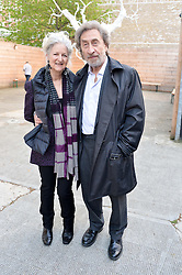 HOWARD JACOBSON and JENNY DE YONG at a private view in aid of Chickenshed of Julian Schnabel's first UK solo show of paintings for 15 years entitled 'Every Angel Has A Dark Side' held at the Dairy Art Centre, 7a Wakefield Street, Bloomsbury, London on 24th April 2014.