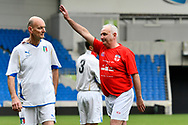Neil Evans of England over 50's celebrates scoring a goal to give a 1-0 lead to the home team during the world's first Walking Football International match between England and Italy at the American Express Community Stadium, Brighton and Hove, England on 13 May 2018. Picture by Graham Hunt.