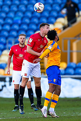 Sam Lavelle of Morecambe and Jamie Reid of Mansfield Town jump to head the ball - Mandatory by-line: Ryan Crockett/JMP - 27/02/2021 - FOOTBALL - One Call Stadium - Mansfield, England - Mansfield Town v Morecambe - Sky Bet League Two