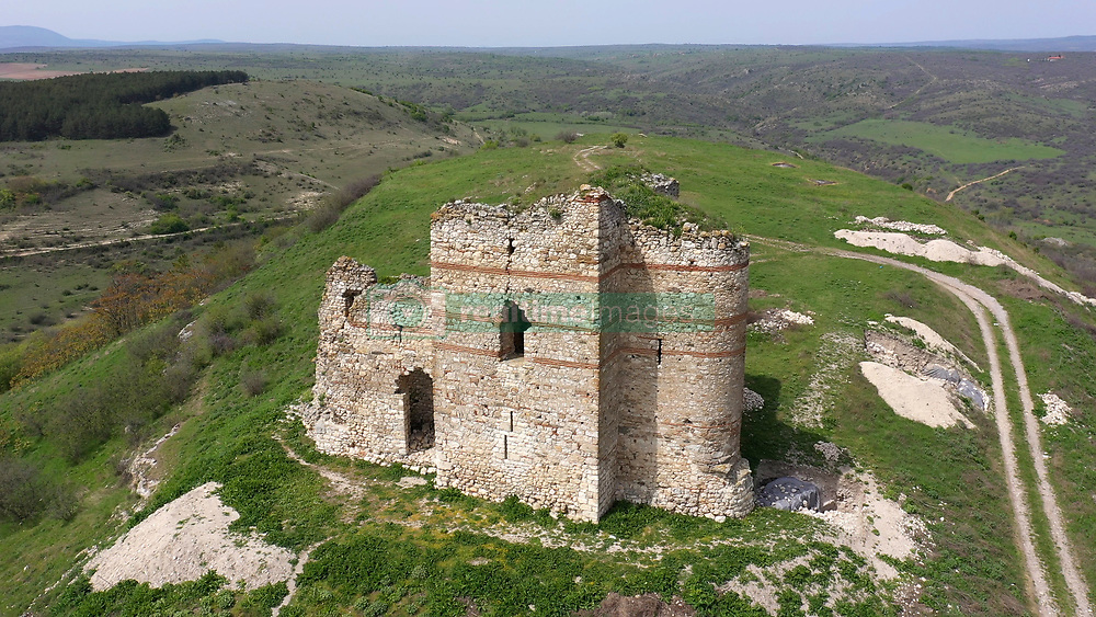 May 1, 2019 - Matochina, Bulgaria - A view of Bukelon fortress near the village of Matochina in Southeastern Bulgaria. Bukelon is the best-preserved fortress of the late Middle Ages in today's Bulgarian lands. The local population is trying to keep this unique fortress from the raids of people living in the nearby villages that break it down to build houses. Tens of years ago, many of the houses in the region were built with stones from the fortress, after which a program to preserve it began, and now many people have decided to take stones from there to build houses, fences and other buildings. Local residents also worry about the raids of refugees coming from Turkey because the fortress and the village are about 500 meters from the border. The height of the remains of the tower is about 18 meters and they represent a magnificent view, filling the panorama of the region. The tourist flow in the area has been drastically reduced due to their concerns about refugee entry and the danger of the collapse of the fortress as a result of its indiscriminate long-standing demolition. On April 14, 1205, the Adrianople battle took place in which Tsar Kaloyan's armies defeated the knights of the Fourth Crusade and captured the master of the Latin Empire Baldwin I Flanders. Photo by: /Impact Press Group/NurPhoto (Credit Image: © Impactpressgroup.Org/NurPhoto via ZUMA Press)
