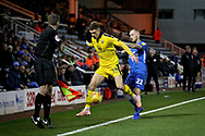 Oxford United's Josh Ruffels (14) see's the ball out under pressure from Peterborough United midfielder Marcus Maddison (21) during the EFL Sky Bet League 1 match between Peterborough United and Oxford United at London Road, Peterborough, England on 8 December 2018.