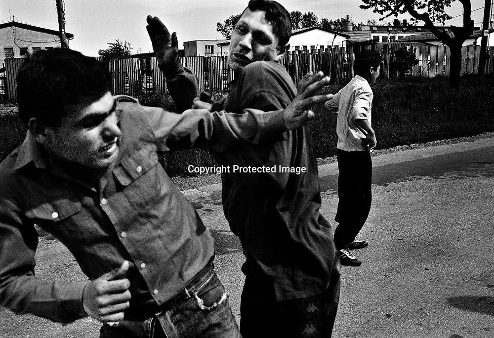 Young men fighting.