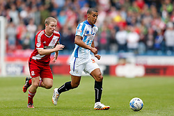 Lee Peltier of Huddersfield is challenged by Grant Leadbitter of Middlesbrough - Photo mandatory by-line: Rogan Thomson/JMP - 07966 386802 - 13/09/2014 - SPORT - FOOTBALL - Huddersfield, England - The John Smith's Stadium - Huddersfield town v Middlesbrough - Sky Bet Championship.
