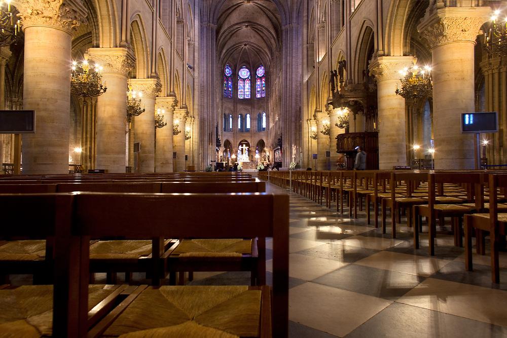 Paris, Ile de la Cite, France - April 07, 2010: Empty chairs at the interior of Notre Dame Cathedral.