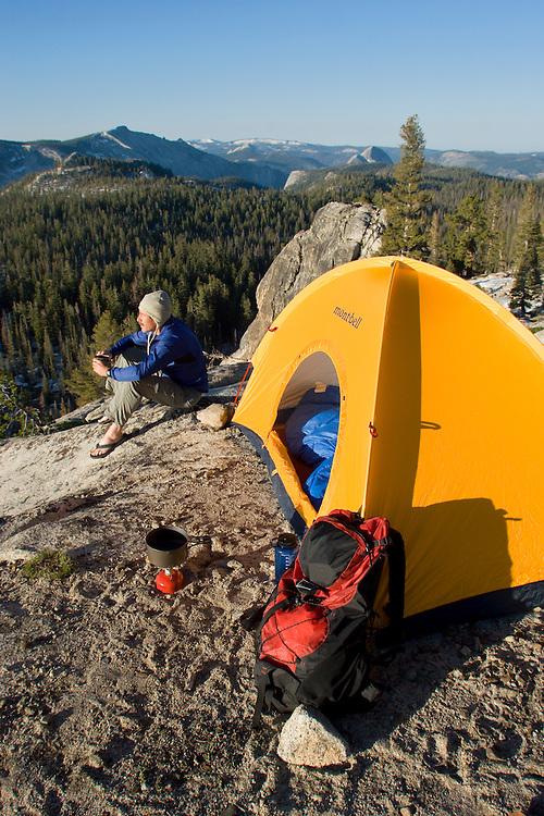 Man backpacking in Tuolumne Meadows. Yosemite National Park, CA