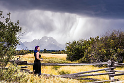 Lauren Coleman pausing from her photography to take it all in at Grand Teton National Park.