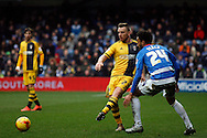 Jamie O'Hara making a pass whilst under pressure from Queen's Park Rangers player James Perch.  Skybet football league championship match, Queens Park Rangers v Fulham at Loftus Road Stadium in London on Saturday 13th February 2016.<br /> pic by Steffan Bowen, Andrew Orchard sports photography.