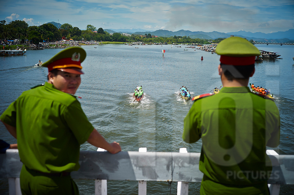 Military audience during a boat race on Perfume River, Hue, Vietnam, Southeast Asia