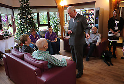 Prince Charles (known as The Duke of Rothesay when in Scotland) chats with patients during his visit to the Ayrshire Hospice in Ayr where he met patients and their families, staff and volunteers, with standing-volunteer occupational therapist George Bell (left) and patient Jim Fitzsimmons (centre right) and occupational therapist Joan Carrigan (right).