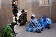 French troops talk with locals in Timbuktu after taking the city back from Islamic militants on Jan. 30, 2013.