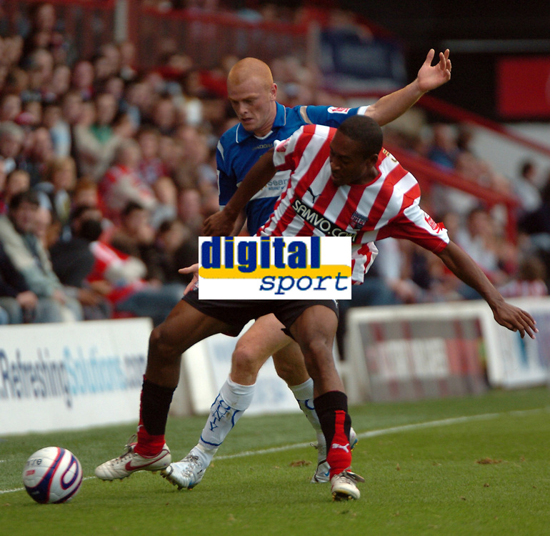 Photo: Tony Oudot.<br /> Brentford v Stockport County. Coca Cola League 2. 29/09/2007.<br /> Ricky Shakes of Brentford tackles Jason Taylor of Stockport