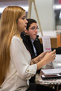 Purchase, NY – 31 October 2014. Dayanna Rios, from Ossining High School, gathering her highlighted case notes. The Business Skills Olympics was founded by the African American Men of Westchester, is sponsored and facilitated by Morgan Stanley, and is open to high school teams in Westchester County.